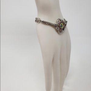 CHANEL cc silver, silver tone camellia bracelet.